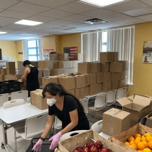 Food Pantry employee packing food for redistribution.