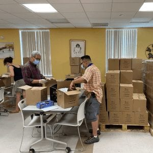 Food Pantry employees packing food for redistribution.
