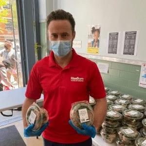 Scott Short, RiseBoro CEO, packing food for redistribution.